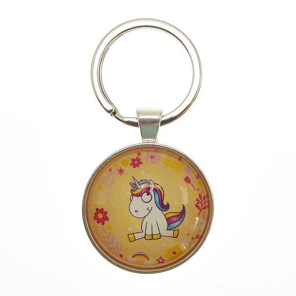 Ausgefallenkleineaufmerksamkeiten - Schlüsselanhänger mit sitzendem Einhorn orange - Onlineshop 1a Geschenkeshop